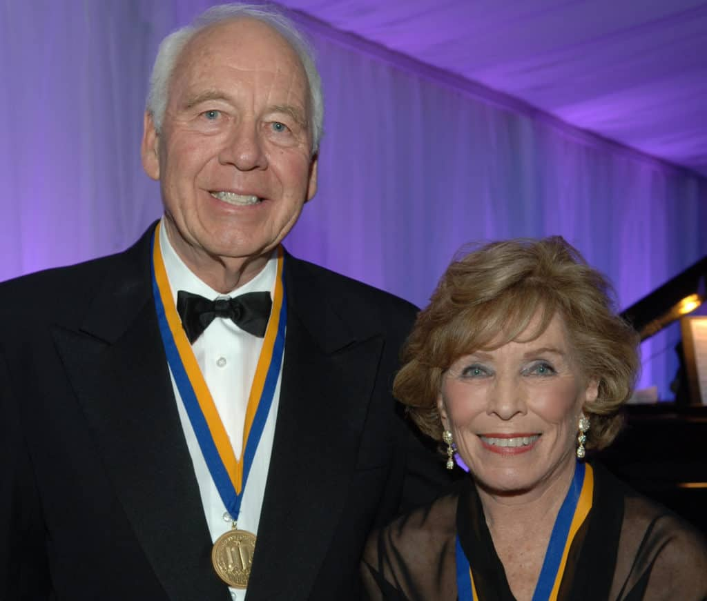 Wilson and his wife with UCLA medals