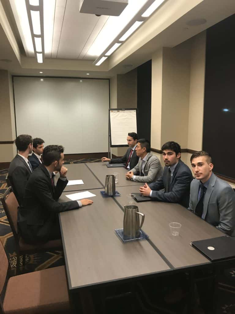 Tim Cheung engaged with business majors